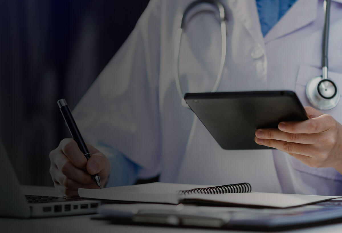 Doctor checking medical records on computer