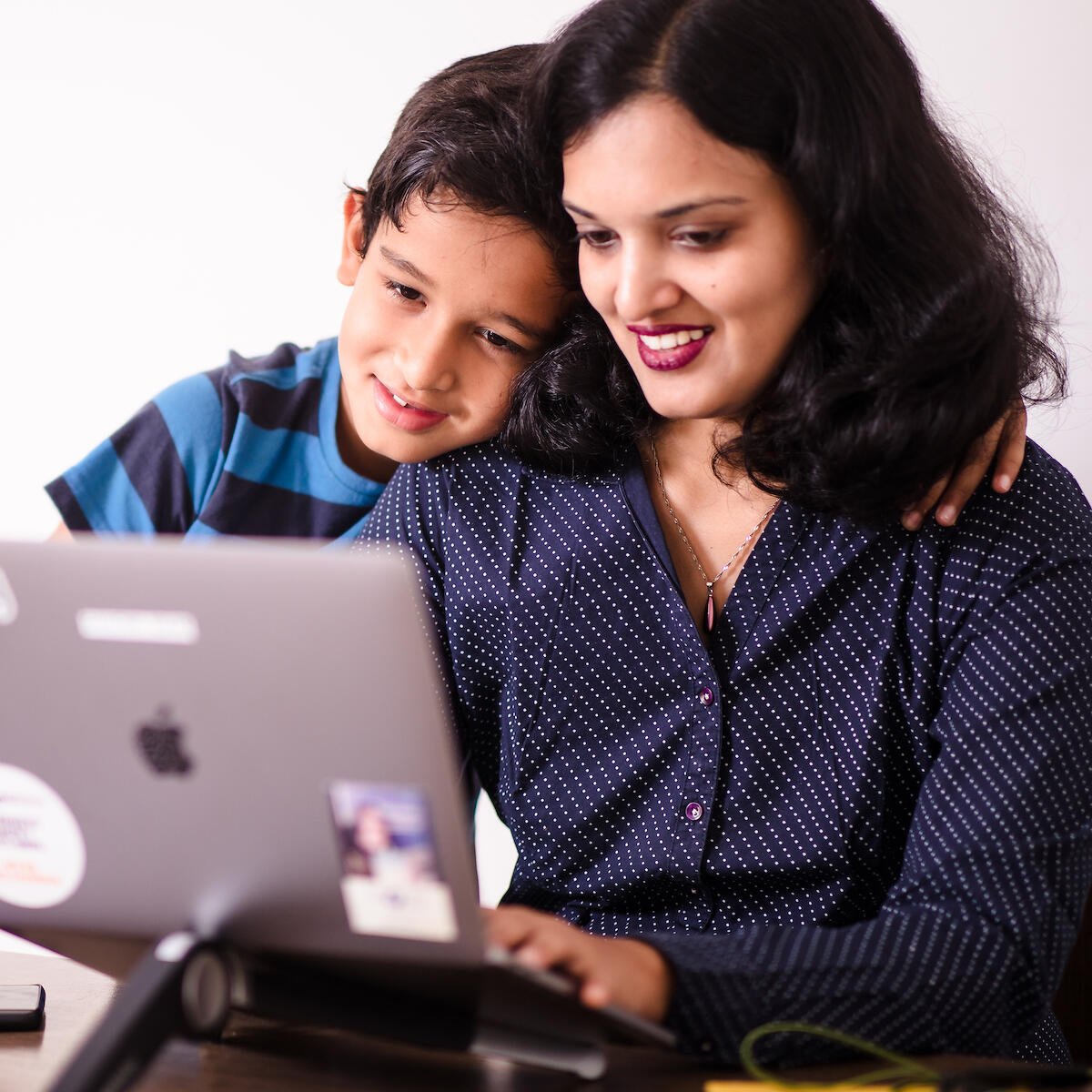 Image of ThoughtWorker and her son at work
