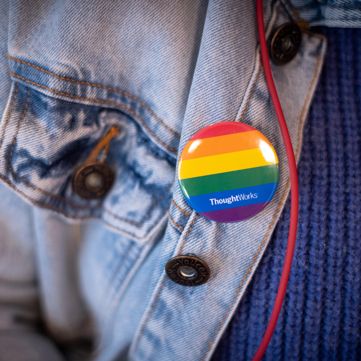 Image of a ThoughtWorks pride rainbow badge