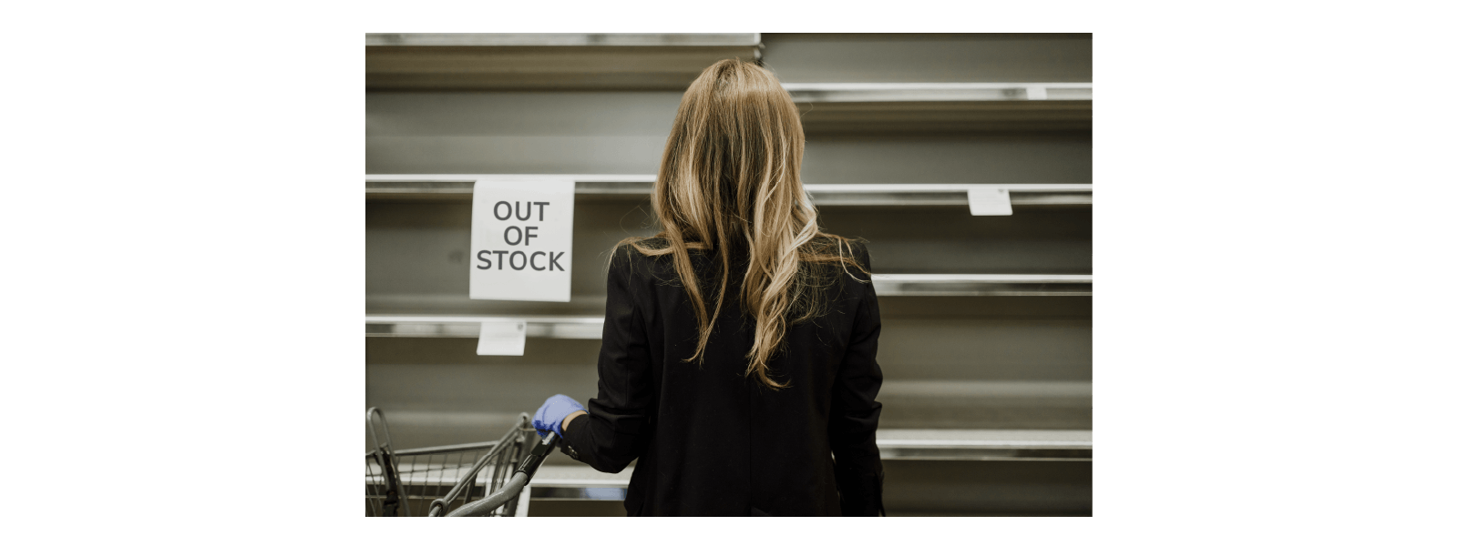 Lady looking at 'Out of Stock' shelves