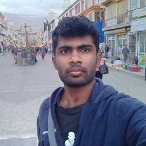Dinesh B